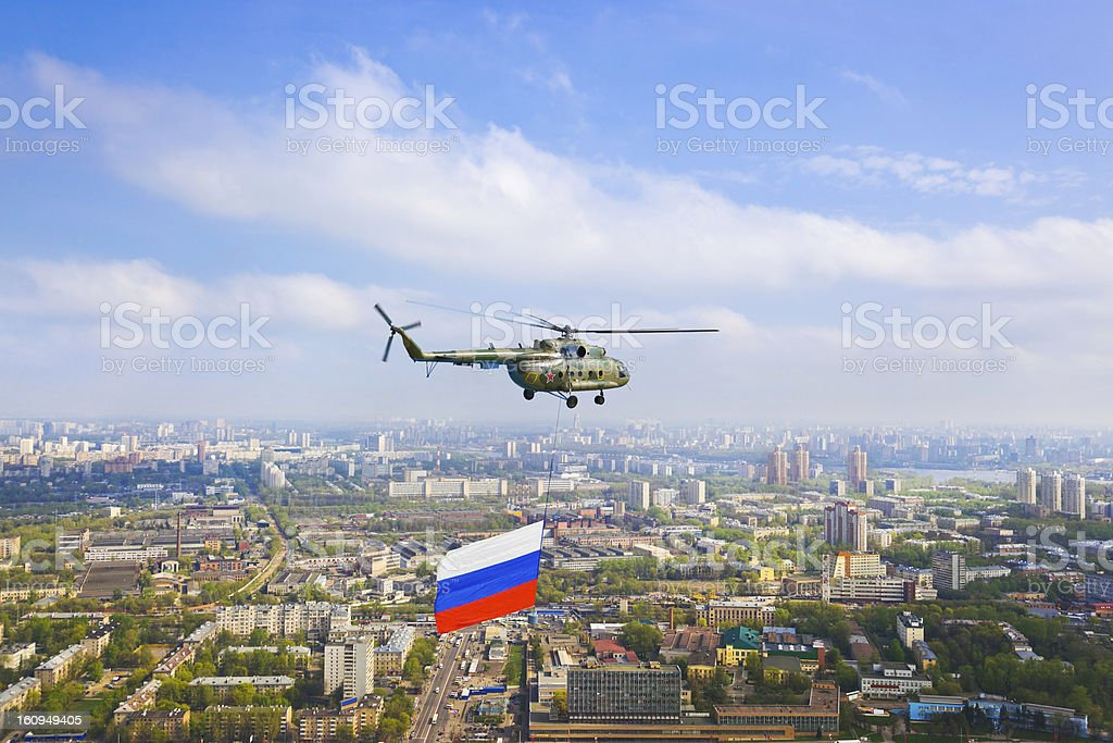 Helicopter with russian flag over Moscow royalty-free stock photo