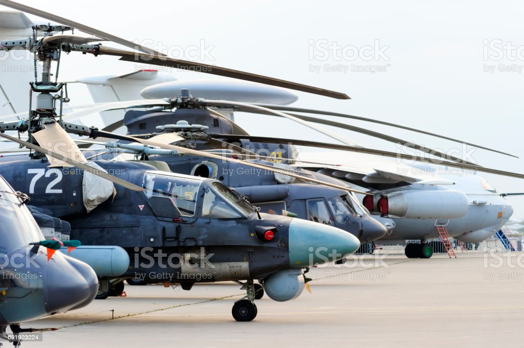 Helicopters and planes in row stock photo