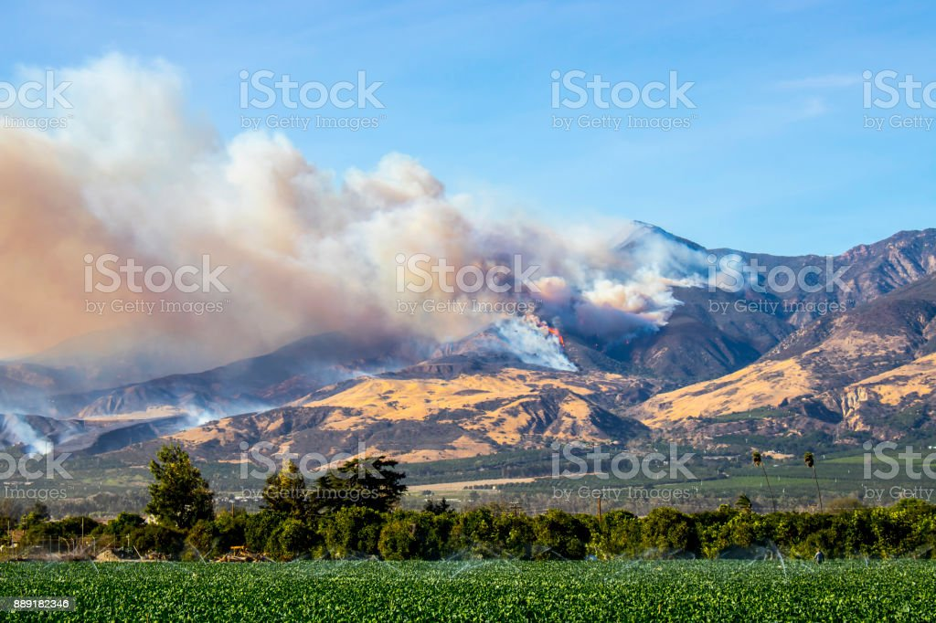 Helicopters Fight Wildfire in Hills in California stock photo