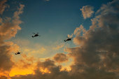 Three helicopters in the sky