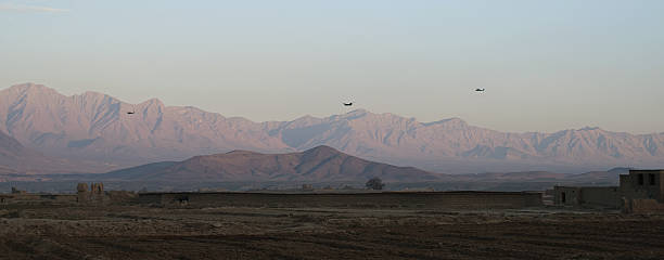 Helicopters in Afghanistan 3 helicopters flying from Kabul in the direction of Bagram Afghanistan stock pictures, royalty-free photos & images
