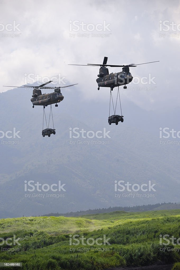Helicopters transporting Cars stock photo