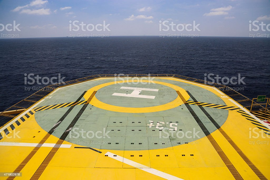 Helideck of oil and gas drilling rig in offshore industry, stock photo