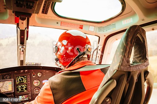 Pilot performing heli-transport flight through the Swiss Alps.