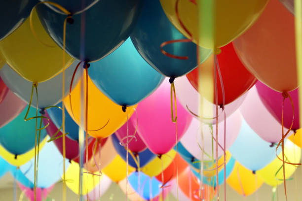 Helium balloons with ribbons in the office Colorful festive background for birthday celebration, corporate party birthday background stock pictures, royalty-free photos & images