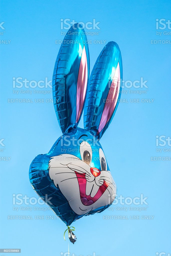 Helium baloon in shape of Disney's character Buggy Bunny stock photo