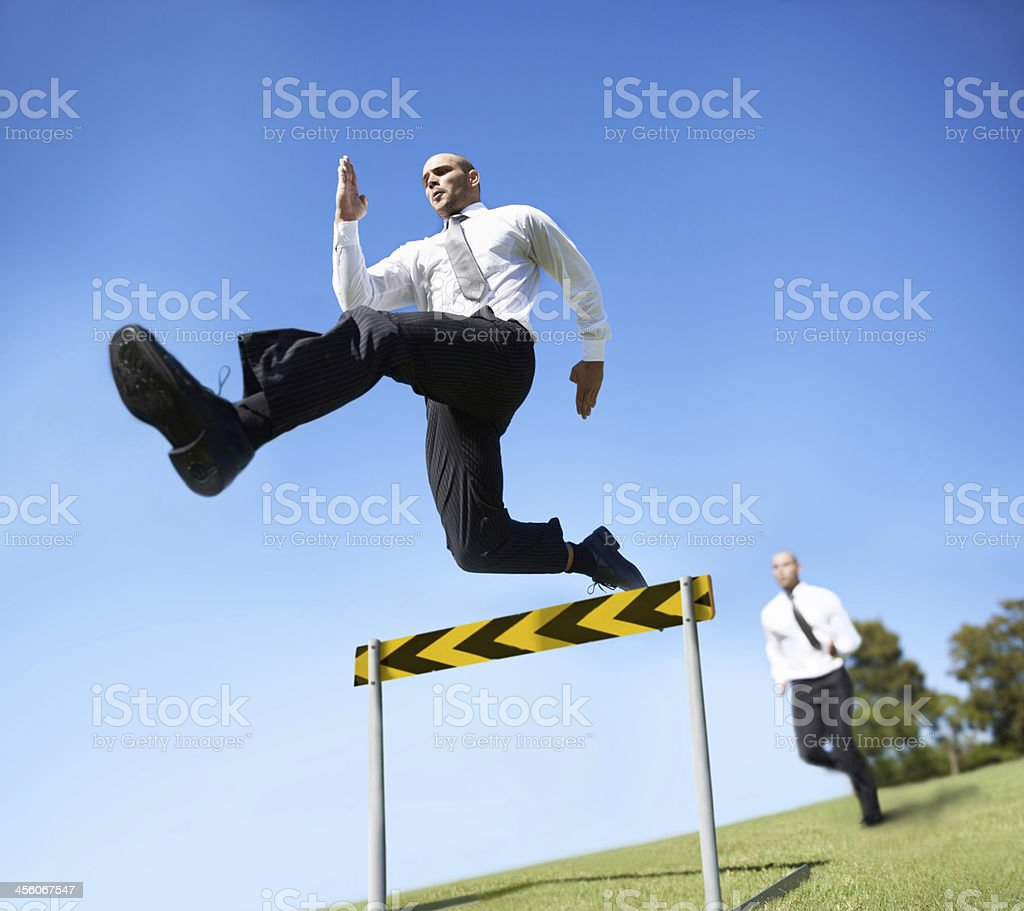 He'll jump over every obstacle stock photo