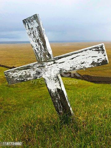 Hellissandur, Iceland: Ingjaldshólskirkja Gravesite Wood Cross. Hellissandur is on Snaefellsnes Peninsula.