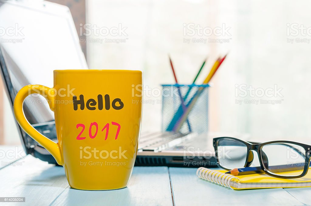 Hello 2017 on morning coffee cup. New year concept at stock photo