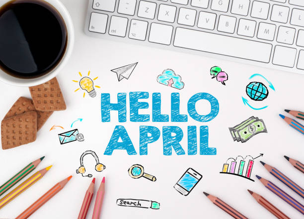 hello april, business concept. computer keyboard and cup of coffee on a white table - welcome march stock photos and pictures