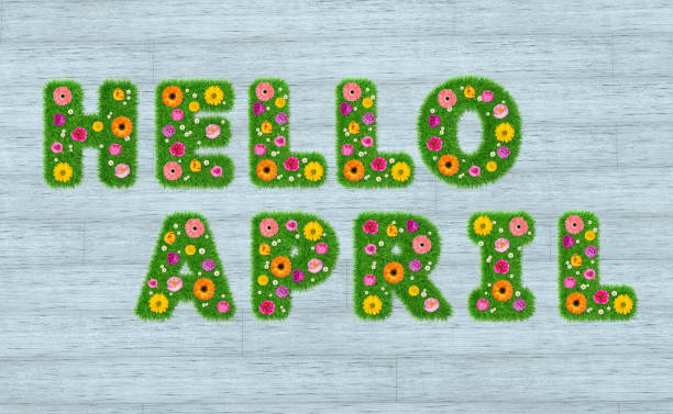 Hello April inscription from the letters of grass with flowers against a background of boards. 3D render. stock photo