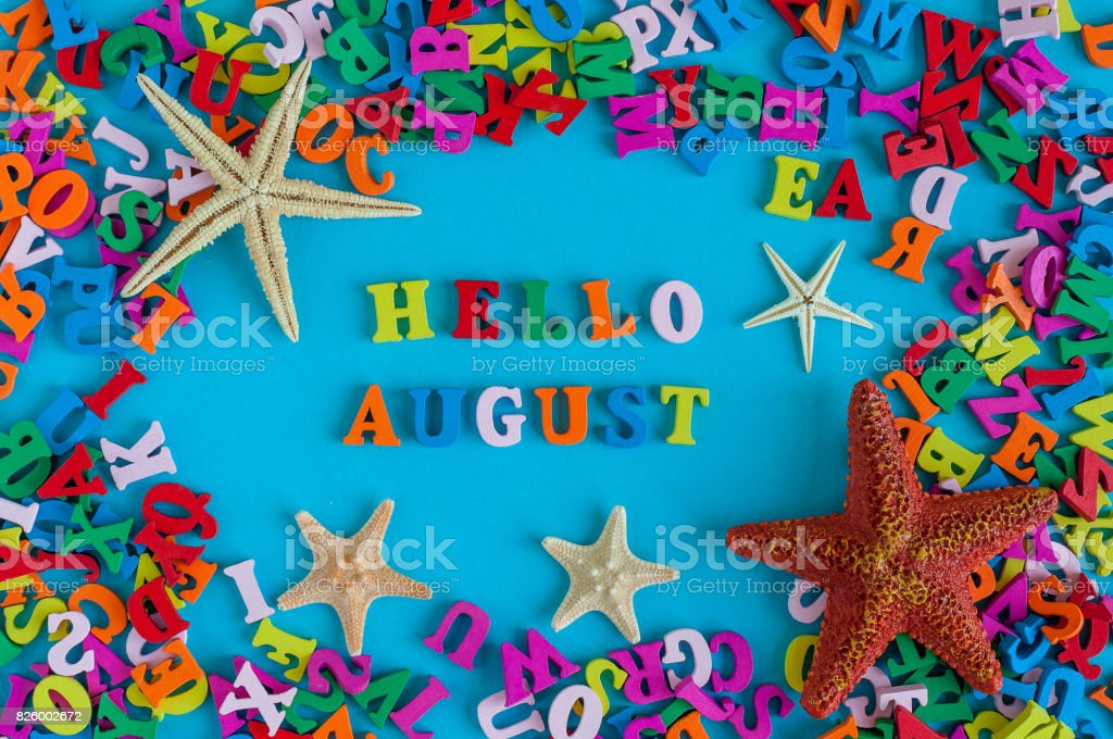 Hello August - inscription at blue summer background. Summer month, beach and sea symbols - starfish. Vacation concept stock photo