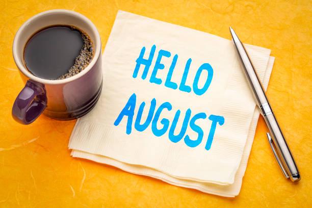 Hello August note on napkin stock photo