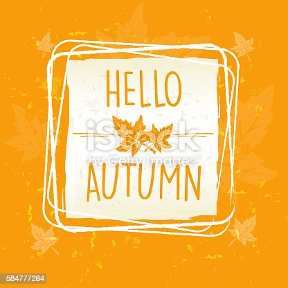 istock hello autumn in frame with leaves, old paper background 584777264