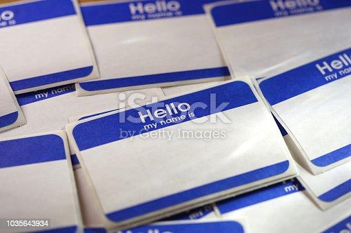 close up shot of hello badges