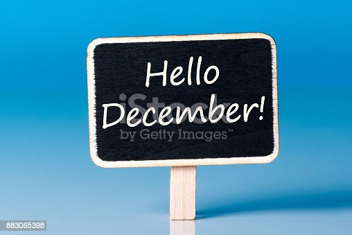 istock Hello december on sign at blue background. December 1st, the beginning of the Christmas and New Year holidays and sales 883065398