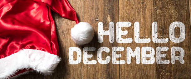 Hello December sign Hello December written on wooden background with Santa Hat december stock pictures, royalty-free photos & images