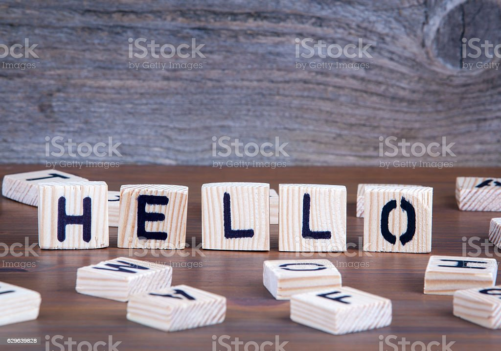 Hello from wooden letters on wooden background stock photo