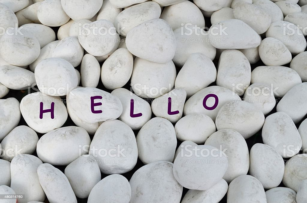 Hello greeting on white marble stones stock photo