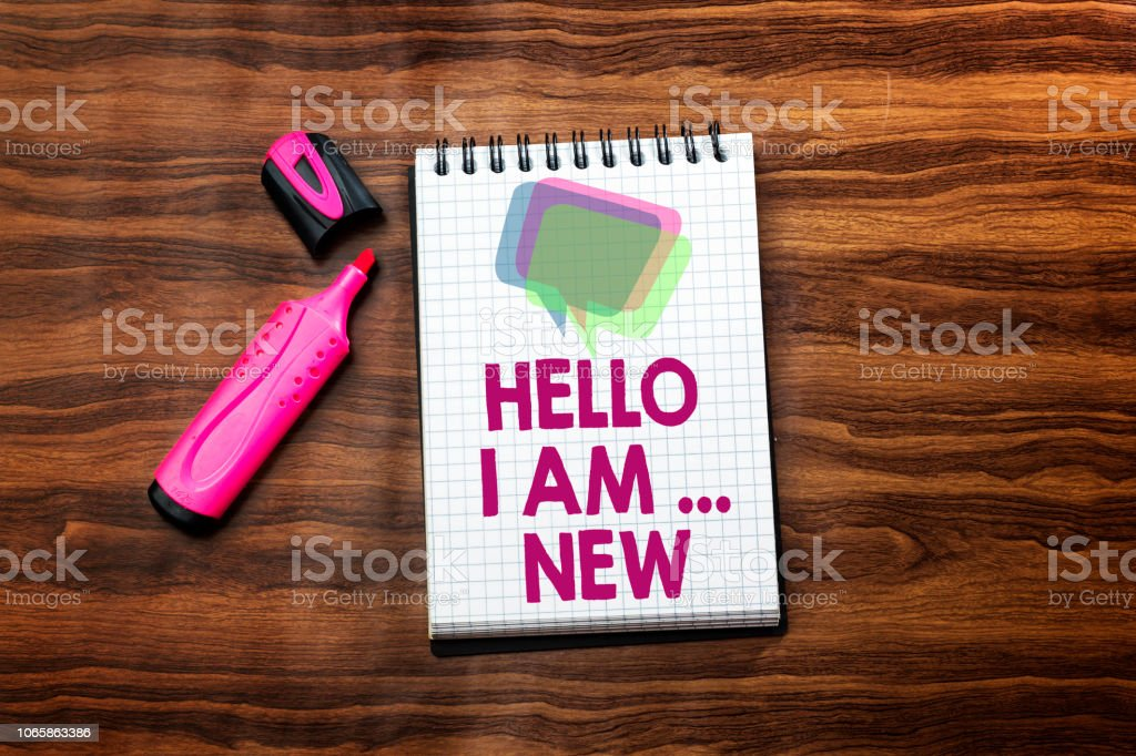 hello i am new text concept in notebook on wood table with pink felt pen stock photo
