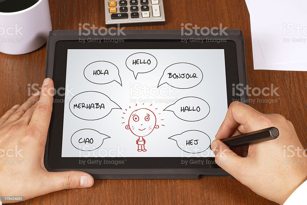 Hello in Different Languages Hello in Different Languages in digital tablet Boundary Stock Photo