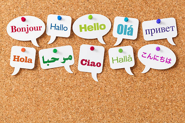 hello in ten different languages on white speech bubbles - translator stock photos and pictures