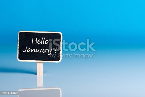 istock Hello january on sign at blue background with empty space for text, mockup. January 1st, the beginning of the New Year holidays and sales 891466078