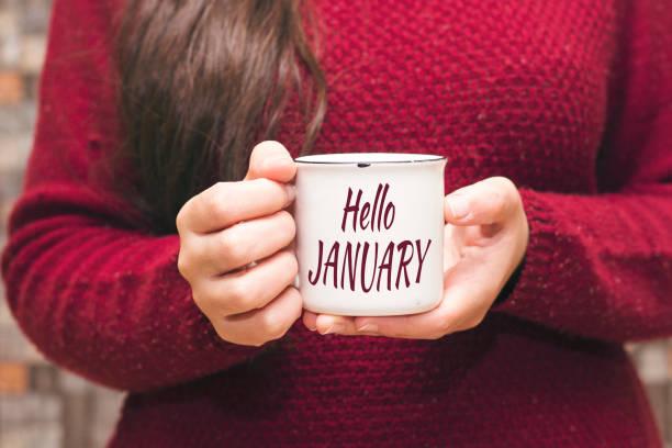 hej januari text på cup och kvinna dricker en kaffe - januari bildbanksfoton och bilder