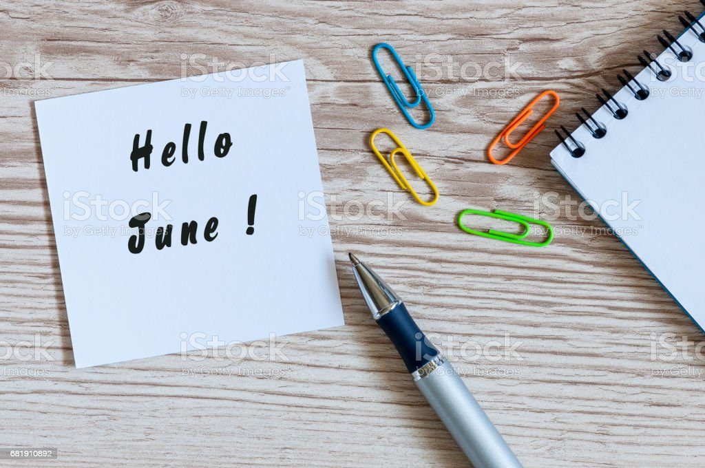 Hello June - notice at home or office workplace. First summer month beginning stock photo