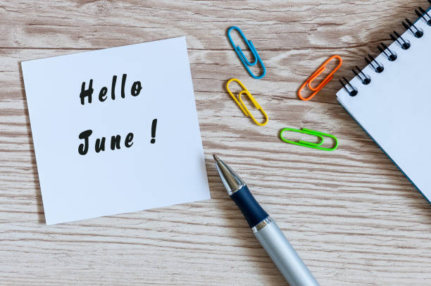 hello june - notice at home or office workplace. first summer month beginning - june stock photos and pictures