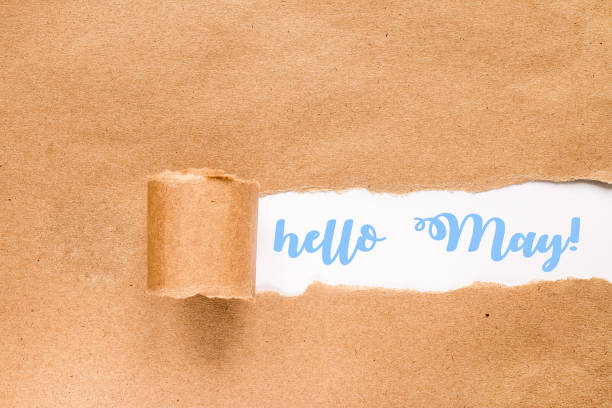 Hello may concept. Inscription in torn envelope. stock photo