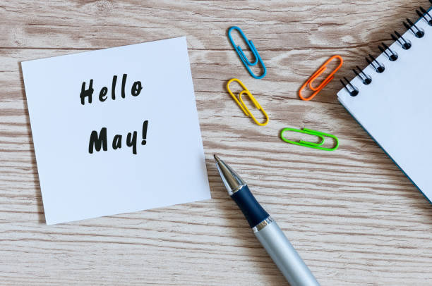 Hello May on message at paper at workplace at office or home stock photo