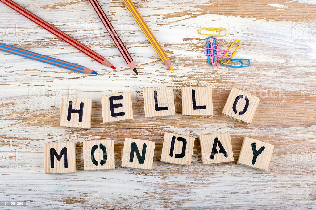 Hello Monday from wooden letterson on wooden background stock photo