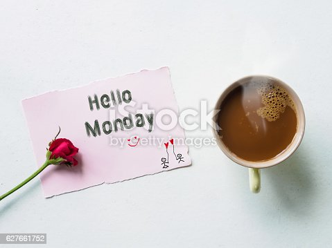 istock Hello Monday message  and coffee with red rose flowers 627661752