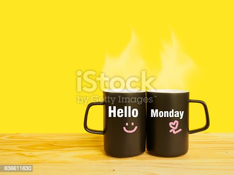 istock Hello Monday message on couple coffee or tea cup 636611630