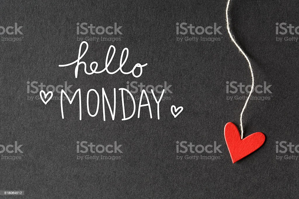 Hello Monday message with paper hearts stock photo