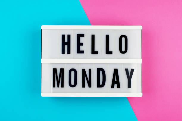 hello monday - text on a display lightbox on blue and pink bright background. - monday motivation stock photos and pictures