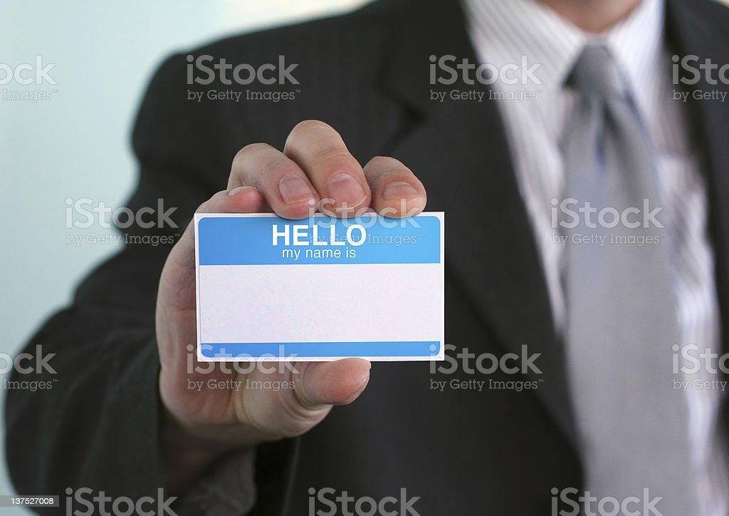 """Hello my name is... Man holding a card that says """"Hello my name is"""" with blank space for your message. Social networking, business, and other networking concepts Adult Stock Photo"""