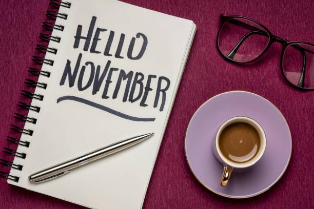 Hello November handwriting in a sketchbook stock photo