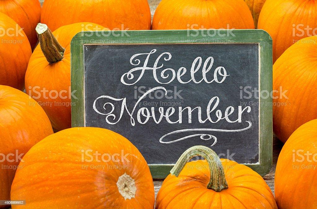 Hello November - white chalk handwriting on a vintage slate...