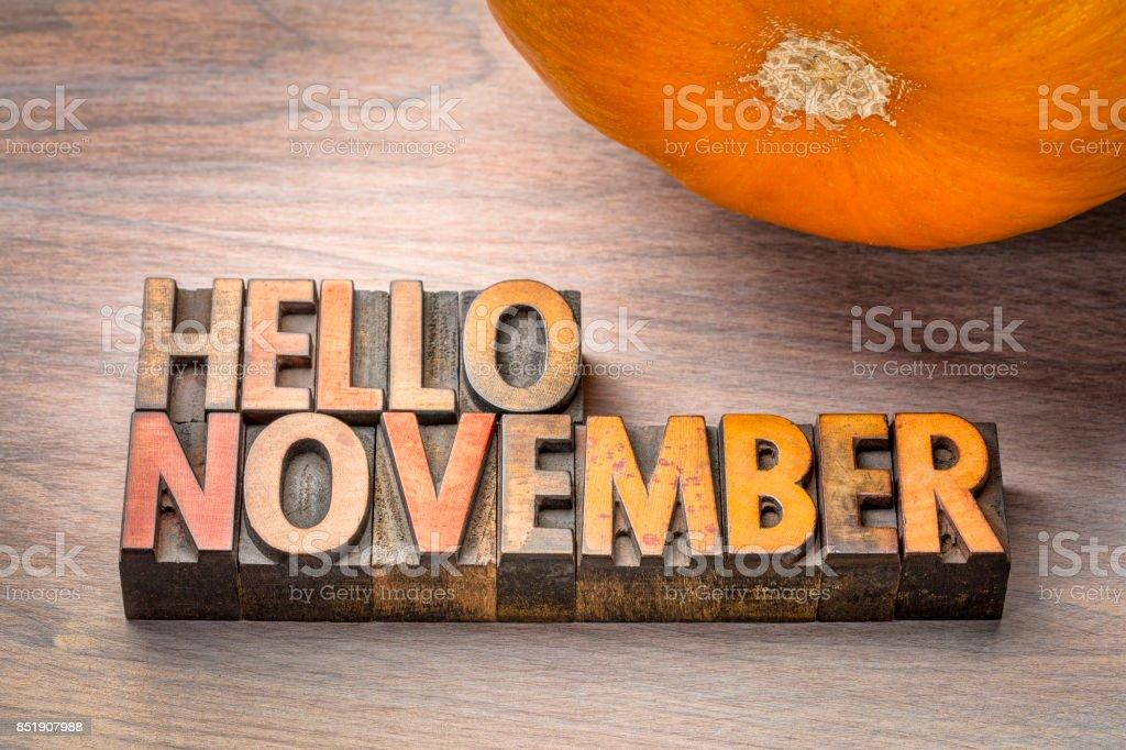 hello November greeting card - letterpress wood type blocks against...