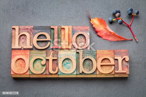 hello October greeting card - letterpress wood type blocks against gray slate stone