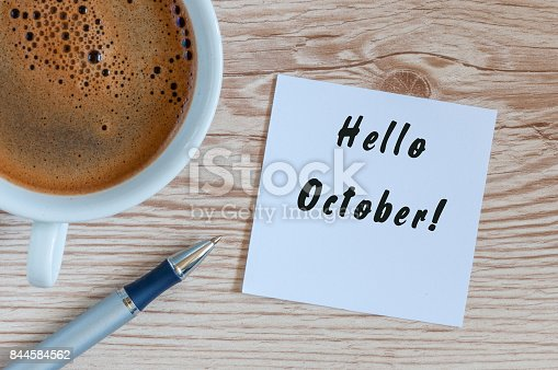 istock Hello October written on notepad with morning coffee cup at business office workplace. Autumn time 844584562
