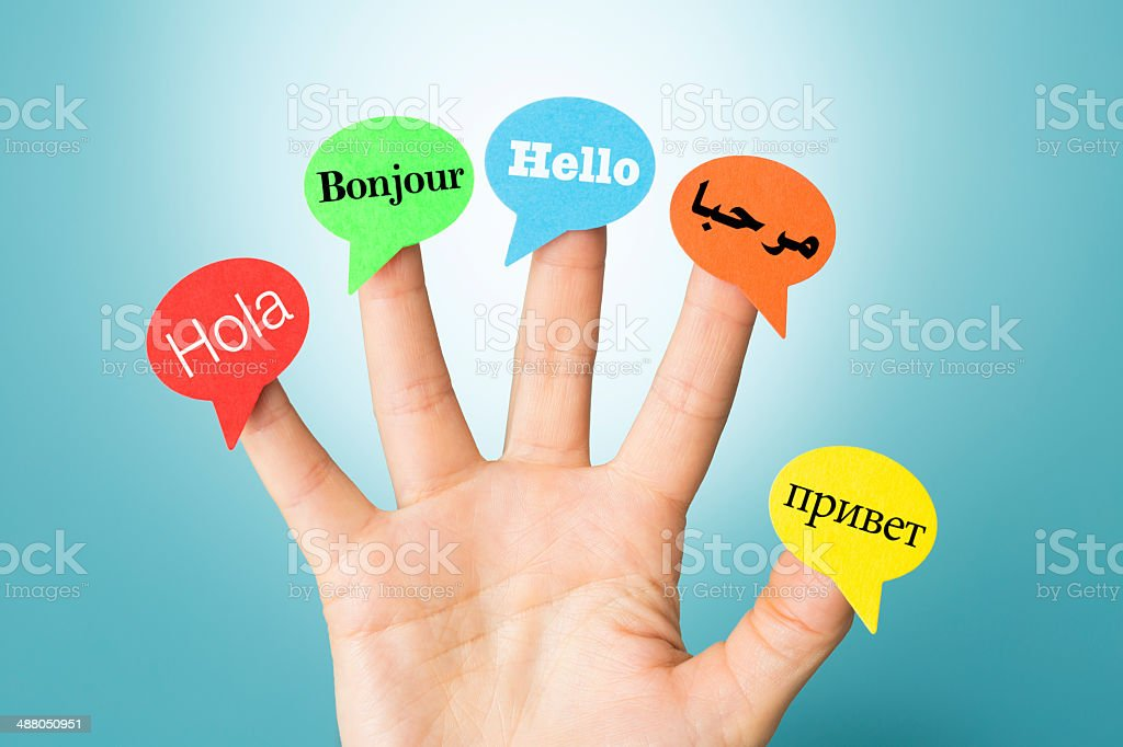 Hello on hand in five different languages with speech bubbles stock photo