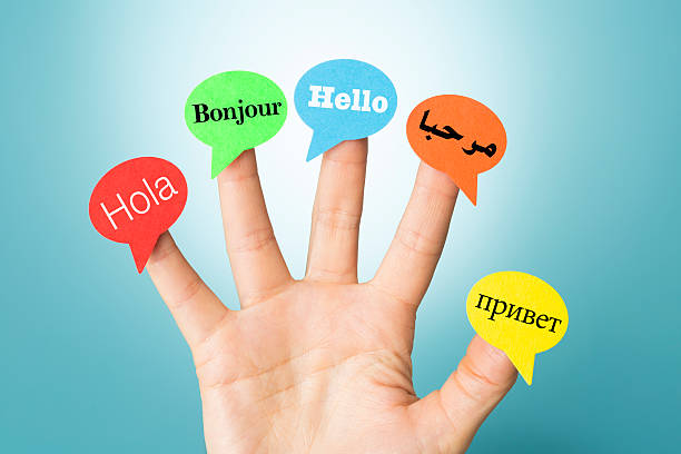 hello on hand in five different languages with speech bubbles - translator stock photos and pictures