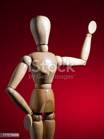 A wooden mannequin greeting.