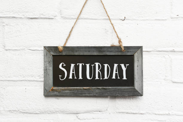 Hello Saturday finally weekend text on chalkboard stock photo