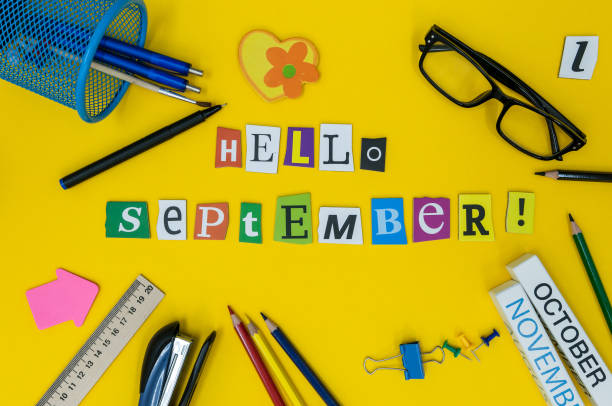 hello september text on light yellow background with school suplies. back to school time concept - september stock photos and pictures