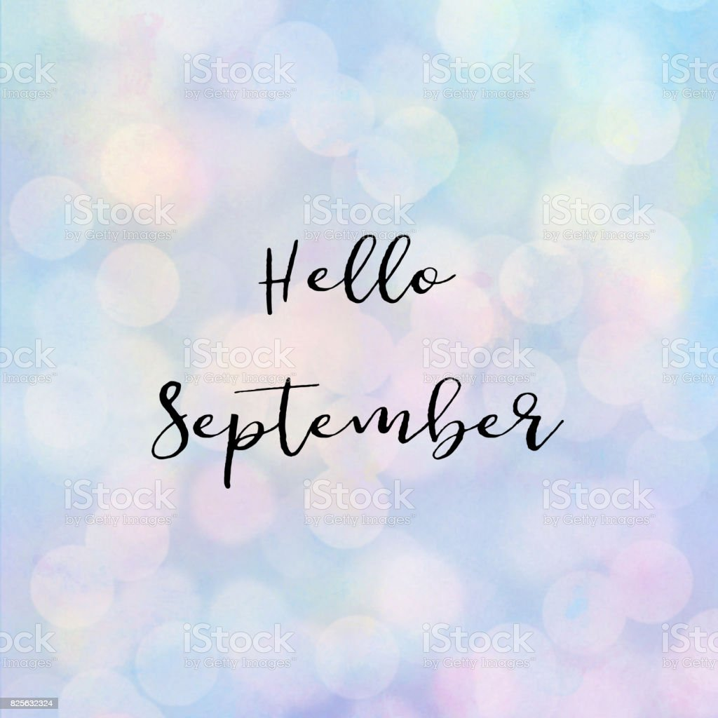 Hello September text with bokeh light stock photo