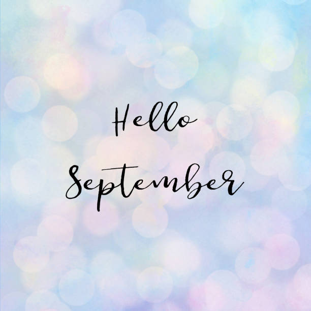 hello september text with bokeh light - september stock photos and pictures